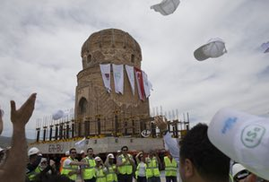 Workers celebrate after the successful relocation of the monument.
