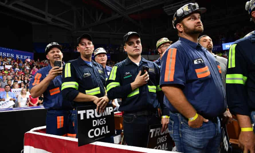 Supporters of of Donald Trump wearing mining gear attend a rally in Charleston, West Virginia, in 2018.