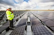 UK green energy investment halves after policy changes...
